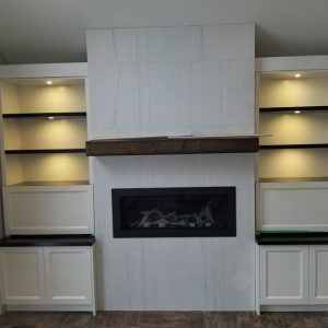 Two tone fireplace cabinetry